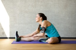 woman stretching on exercise mat